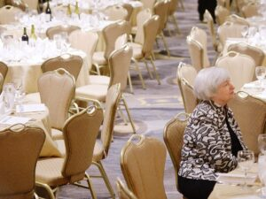 Fed Reserve Chair, Janet Yellen sits at the annual White House Correspondent's Dinner waiting for the gala to begin.
